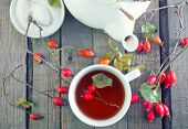 stock photo of home remedy  - fresh tea with rosehip on a table - JPG