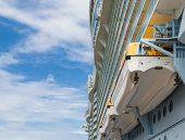 pic of cruise ship caribbean  - Lifeboats Hanging from Side of Luxury Cruise Ship - JPG