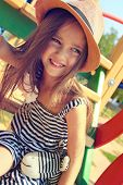 pic of playground  - little girl on outdoor playground equipment - JPG