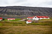 stock photo of iceland farm  - Typical Farm House at Icelandic Fjord Coast - JPG