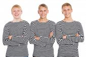 stock photo of conscript  - Smiling guys in a striped shirt with arms crossed - JPG