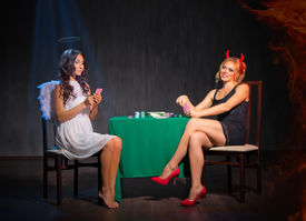 image of sharpie  - Angel and devil playing cards at room - JPG