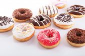 pic of icing  - Delicious donuts with icing isolated on white - JPG