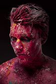 image of bloody  - A creepy portrait of a halloween man with bloody body art and face art.