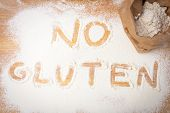 foto of wheat-free  - the words NO GLUTEN written on gluten free flour overhead view - JPG