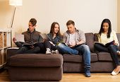 foto of exams  - Group of students preparing for exams in apartment interior  - JPG
