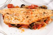 foto of bass fish  - White Fish Fillet with onion tomatoes and black olives - JPG