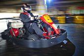 picture of karts  - Businessman enjoying kart racing - JPG