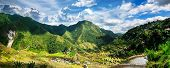 picture of amaze  - Amazing panorama view of rice terraces fields in Ifugao province mountains under cloudy blue sky - JPG