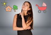 picture of buggy  - Business woman thinking over buggy and house with tree - JPG