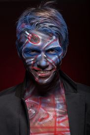 stock photo of mauri  - A creepy portrait of a halloween man with bloody body art and face art - JPG