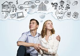 foto of family planning  - Young happy family couple dreaming of future wealthy life - JPG