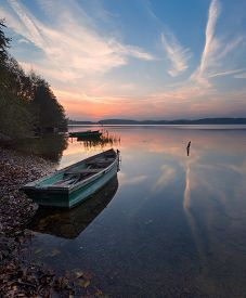 pic of reflections  - Beautiful lake sunrise with sky reflections in water - JPG