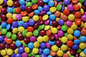 stock photo of green-blue  - Closeup of the pile of colorful sweet bonbons - JPG