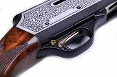 image of shotgun  - Detail of a shotgun and bullets isolated on white background - JPG