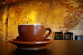 foto of coffee-cup  - cappuccino coffee cup and saucer in a funky interior - JPG