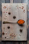 picture of saffron  - Spice Saffron in old metal spoon over wooden background - JPG