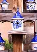 picture of peddlers  - Ceramic Birdhouses with Blue and Whit orrnate designs - JPG