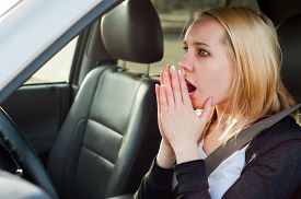 picture of panic  - Scared young student girl panic in a car - JPG