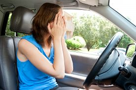 image of panic  - Scared young student girl panic in a car - JPG