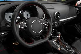 foto of steers  - Photo of a Luxury car interior with steering wheel