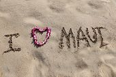 I LOVE Maui. the words I love maui written in sand on the beach with a Hawaiian lei for the heart sy poster