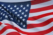 stock photo of usa flag  - The American flag flying from a pole gently flapping with the wind - JPG