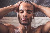 Afro American Man Taking Shower poster