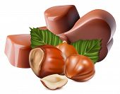 Photo-realistic vector illustration. Chocolates and hazelnuts.