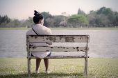 Beautiful Lonely Woman In Frustrated Depression Sitting Alone On Bench In Park., Concept Of Lonely, poster