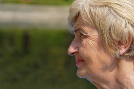 image of wrinkled face  - Wrinkled profile of a senior woman in nature - JPG