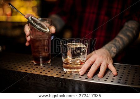 Bartender Holding A Glass Of