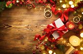 Christmas Gifts on wooden background, beautiful Xmas and New Year backdrop with colorful wrapped gif poster