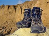 image of welts  - Tourists boots on stone in mountains - JPG