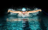 Professional man in swimming pool. Butterfly swimming style poster