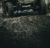 Getting The Most Out Of The Off Road Adventure. Car Wheels On Steppe Terrain Splashing With Dirt. Ca poster