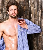 Drink Wine And Relax. Bachelor Enjoy Wine. Macho Tousled Hair Degustate Luxury Wine. Erotic And Desi poster