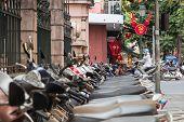 Scooters, Traffic And Communist Propaganda Symbol In Hanoi, Vietnam poster