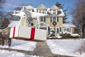 Unmanned Aircraft System (UAV) Quadcopter Drone Delivering Box With Red Ribbon To Home poster