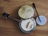 Close-up Of Three Brazilian Musical Instruments Seen From Above: Samba Banjo (strings), Pandeiro (ta poster