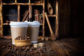 Disposable Take-out Mock-up Paper Cups With Coffee Beans On Rustic Wooden Background poster