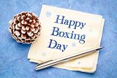Happy Boxing Day -  handwriting on a napkin with a frosty pine cone poster