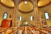 stock photo of pews  - Pews and altar among columns in Madonna Moretta catholic church in Alba - JPG