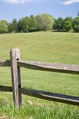 image of split rail fence  - Wood Split Rail Fence with Grassy Landscape Background - JPG