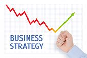 stock photo of wane  - Fist of a man threatens to the descending chart business concept - JPG