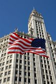 American Flag In Front Of Wrigley Building Chicago, Illinois