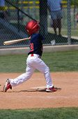 stock photo of little-league  - Little league baseball boy swinging a bat - JPG