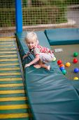picture of bounce house  - Little boy on a children - JPG