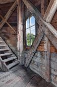 stock photo of chalet interior  - Interior of an abandoned wooden house with staircase and view over green garden - JPG