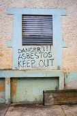 picture of asbestos  - Asbestos warning on an abandoned factory building - JPG